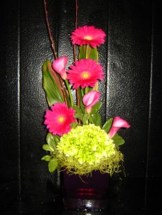 pink and green arrangement with gerbera daisies, calla lilies and hydrangea