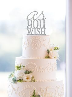 This wedding cake topper features the iconic Princess Bride saying As You Wish, by Chicago Factory
