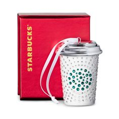A limited edition ceramic white cup ornament set with Swarovski® crystals.