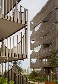 Scalloped balconies create unusually shaped openings across the facades of these two apartment blocks completed by Tham & Videgård Arkitekter in Jönköping, Sweden.  - photo by Åke E:son Lindman, via dezeen