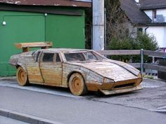 Just think, if this guy put as much time and energy into advancing his career as he did building this wooden Lamborghini he would have been able to afford some hubcaps for it.