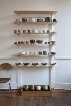 ceramic stand at exilo, photo by roger davies, via pilarwiley.com.