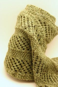 I don't know where the pattern is, but I would love to make this purely because of how elegant it looks! Beautiful knit scarf!