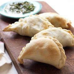 Empanadas filled with squash, corn & spinach served with a side of chimichurri. A dense & flavorful twist on this classic Argentinean dish.