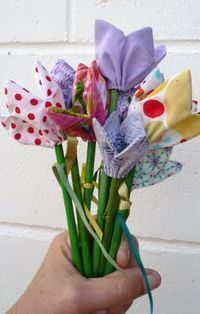 fabric tulips tutorial from clarescraftroom.blogspot; I'm thinking a small amount of PolyFil stuffing in the center, sew edges shut & they will look like unopened tulips. She does have patterns for sale - check her blog links.
