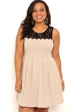 This pretty dress is perfect for your big night. This short plus size homecoming dress features an illusion lace neckline with tank straps and a pleated skater skirt. Strappy black pumps finish off this dress!