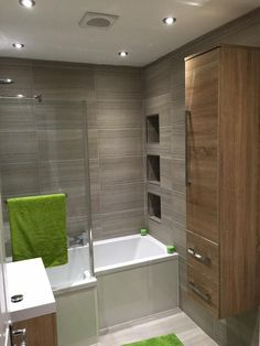 Colin from Newcastle upon tyne uses a mix of wooden finishes and furnishings to achieve a modern design in his bathroom. He saves space with a shower bath to ensure that he gets the most functionality and space efficiency in his small bathroom. New Bathroom Ideas, Family Bathroom, Bathroom Design Small, Bathroom Layout, Bathroom Inspiration, Bathroom Designs, Grey Bathrooms, Bathroom Renos, Bathroom Renovations