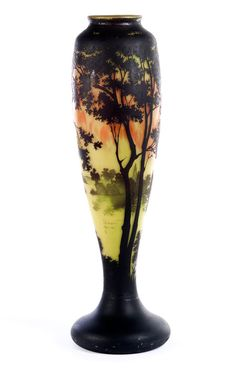 Great Daum vase Round base in the form of a squashed sphere. Vases body upwardly clavate; widening and neck in throat feeding. Etched cased glass and sanded, polished, all-round tree landscape in reddish-yellow evening scene on view between the trees on a lake with island and headlands, which reflects the trees in the water. The color extends from the foot upward from black to green, bright yellow, orange and eggplant fire to appear above silhouetted in the foliage.