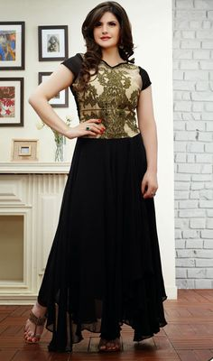 Zarine Khan Beige and Black Georgette Long Anarkali Suit  Go for the sophisticated look as Zarine Khan with this beige and black georgette long Anarkali suit. Beautified with lace, resham and stones work. #LatestChuridarSuits #LatestFashionDresses