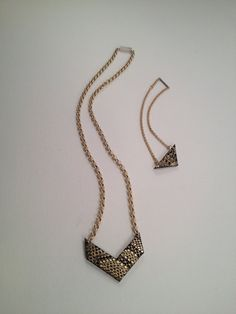 This set is a mother daughter combination the daughters piece is a small triangle on a medium size rolo chain that is completely adjustable.