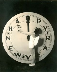 old Happy New Year photo with giant clock and winged lady