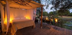 Discover a breathtaking safari experience at Ruckomechi Camp in Mana Pools National Park, Zimbabwe. This luxury tented camp features game drives and more. Tent Camping, Glamping, Luxury Tree Houses, Safari Room, Vintage Safari, Luxury Tents, Light Pollution, Sleeping Under The Stars, Lodges