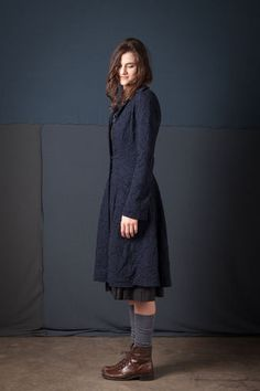 "100% organic medium-weight cotton jersey Ezra Coat with reverse appliqué in our Magdalena stencil. Flares slightly at the waist and features crotcheted snap closures and pockets below the hip. Measures 42"" from shoulder. Shown here in Navy. Choose your color below. Please allow four to six weeks for delivery. Wash gently + Hang to dry. Free shipping. Made in the USA."