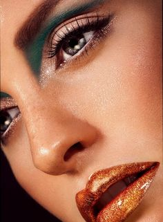 Beauty magazine photo, close up face with brown blush, coppery-metallic lipgloss, teal streak shadow under eyebrow. Photo by Norbert Kniat.