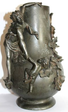 Art nouveau rare large vase pewter?. style bronze. Not signed maybe WMF?. or others?. Very beautiful decor with women and putti. Condition: good except two lacks behind (one leg and one leaf). Total height: 36cm - Diameter maximum: 22cm - Weight: 3,7kg.
