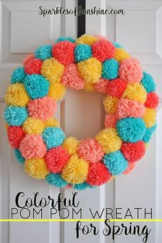 Learn how to make an easy colorful pom pom wreath for Spring, step by step at Sparkles of Sunshine.