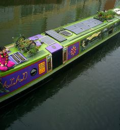 Unusually coloured Narrowboat with solar panels.