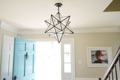 Glass & metal star shaped light fixture