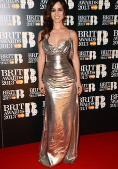 BRIT Awards 2013: Skyfall star Berenice Marlohe went for a metallic halterneck that highlighted her curves ©Getty