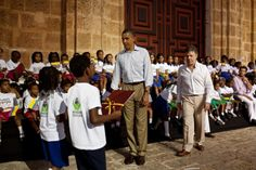 President Barack Obama and President Juan Manuel Santos of Colombia participate in a presentation of land titles to the Afro-Colombian community at the Plaza de San Pedro in Cartagena, Colombia