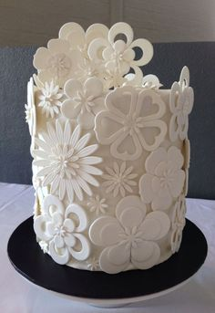 White Cut Out Flower Wedding Cake - A Double Barrel Chocolate Mud with ganache. The bride supplied a picture of a similar cake by Pamela McCaffrey ~Made With Love~.: