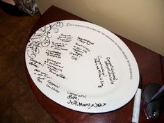 a great wedding keepsake - guests sign a platter with indelible ink