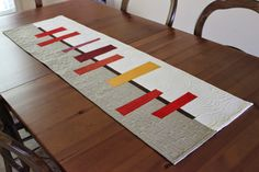 Teaginny Designs: Autumnal Table Runner - like the Oakshott solids used for this modern table runner Table Runner And Placemats, Table Runner Pattern, Quilted Table Runners, Patchwork Quilting, Quilting Room, Skinny Quilts, Modern Table Runners, Contemporary Table Runners, Mid Century Modern Table