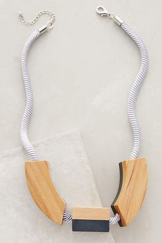 Anthropologie's pick for their US stores | Wood and Resin Flip Pendant on chord  Pieced Wood Necklace - anthropologie.com