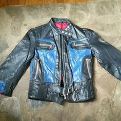 Vintage Leather Moto Jacket 1980s Amazing early 1980s blue and black leather motorcycle jacket! It has a few normal signs of wear ( see last photo). Measures about 15.5 inches from armpit to armpit when flat, 13.5 inches from armpit to end of sleeve, and 15.5 inches from shoulder seam to shoulder seam. There might have once been a silver tone buckle on the front bottom strap. Reasonable offers welcome through the offer button. Bundle 2 or more items and save! Harro Jackets & Coats