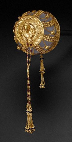 Ancient Greek golden hairnet featuring Aphrodite and Eros, Dionysiac masks, a Herakles knot and other symbolic details. (The J Paul Getty Museum)