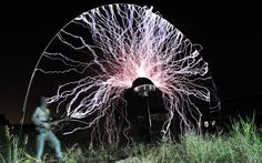 Pictures of the day: 15 August 2012  Chinese musician Wang Zengxiang plays guitar as up to one million volts, generated by a Tesla coil transformer, runs through his body during a performance in Fujian...