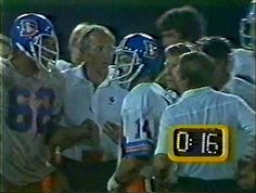 Guard TOM GLASSIC (62), defensive coordinator JOE COLLIER and quarerback NORRIS WEESE (14)--September 11, 1978