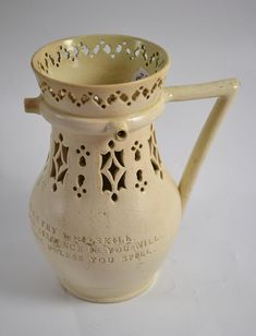 Tennants Auctioneers: Leeds pottery puzzle jug with impressed verse (restored)