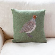 Hand crafted tweed, sage green cushion with partridge applique detail, using Harris tweed and Harris tweed offcuts to make the partridge. Inspired by British game birds. Feather Pad included. Size: 38 x 38 cm Made in the UK Made from Harris Tweed which is almost always made from top quality pure new wool. The fabric always comes from British herds and arrives in a near-raw state where it is dyed and woven in the mill.