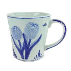 Standard sized coffee mug featuring raised hand painted tulip design with a European motif blue wash. - Check out our other heritage items! - We have other heritage coffee mug designs! - Approximate D