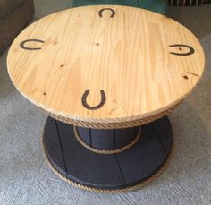 Rustic table made from wooden spool...