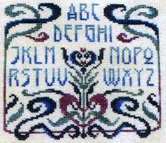 An attractive alphabet sampler with swirling Art Nouveau border.