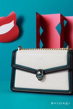 Combining a sharp design and the models striking motif into an intriguing and geometric contrast, the Serpenti Diamond Blast shoulder bag embraces a new seductive nuance for summer season with three-dimensional matelassé pattern and the iconic snakehead closure. Perfect to accessorize a sophisticated day look, the bag features a chunky chain with an adjustable leather strap and detachable handle, for versatile wearability.