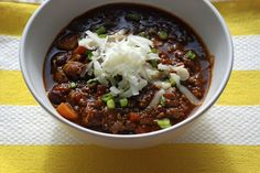Research Chili With Garlic, Olive Oil, Applewood Smoked Bacon, White Onion, Carrots, Celery Ribs, Light Brown Sugar, Rye Whiskey, Ground Beef, Lamb Leg, Cumin, Smoked Paprika, Oregano, Cayenne, Dried Mint, Nutmeg, Dried Parsley, Thyme, Dried Basil, Clove, Dijon Mustard, Serrano Chilies, Tomato Paste, Cider Vinegar, Coffee, Beer, Dark Chocolate, Bay Leaves, Crushed Tomatoes, Kidney Beans, Fresh Thyme, Low Sodium Chicken Stock, Black Pepper, Sea Salt, Scallions, Cheddar Cheese