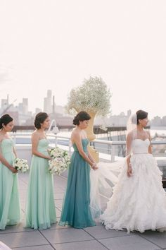Maid of honor wears a different shade of the bridesmaid's dresses to stand out just a little.