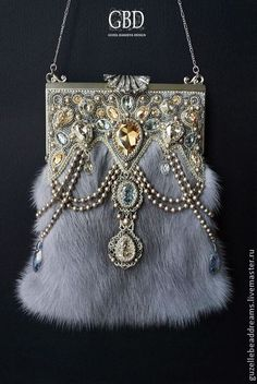 Handbag. silver fur with jeweled top of silver and topaz.