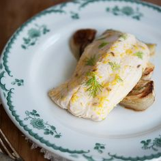 Orange and Fennel Roasted Cod | Fennel lovers get a triple treat with these cod fillets: The fish is anointed with a fennel-seed marinade, roasted on a bed of fennel bulbs, and then sprinkled with chopped fennel fronds before serving.