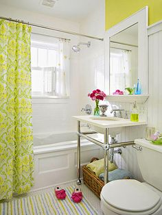 Privacy for shower windows: a small shower curtain rod, trimmed down shower curtain fabric and plantation shutters.