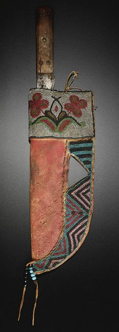 Plains Beaded Hide Sheath With Trade Steel & Wood Knife  --  No further reference provided.