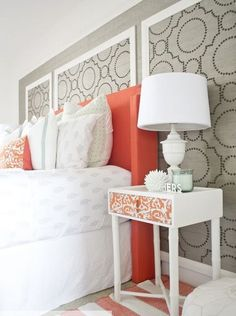 In the bedroom below, wallpapered panels are given a white trim that complements the decor accessories and white furniture.