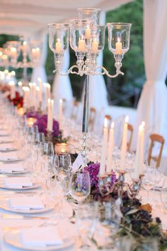 Formal Wedding - Tall Candelabras + Low bunches for centerpieces... So Elegant. See the wedding on SMP: http://www.StyleMePretty.com/destination-weddings/2014/02/28/sweet-destination-wedding-in-umbria/ Photography: Brook Merrill