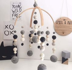 You are buying a deluxe double arch baby mobile with 5 large felt balls in these preset colours (black, white, dark grey & light grey) Deluxe mobiles include crochet & wooden balls, are on a 25cm arch and are approximately 40-45cm top to bottom This mobile can be made with large balls in any of the colours (or mixed colours- just select which option you would like A matching garland can also be added Our mobiles are made from 100% NZ wool felt balls, and are the perfect addition to any…