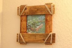 Pallet Wood Picture Frame by BommaritoGlassworks on Etsy.  I like these frames