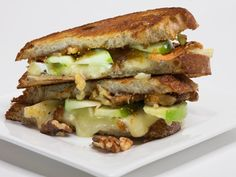 Transport your taste buds to a French café by making a light and savory grilled cheese with brie, your favorite chutney or fruit spread, toasted walnuts and sliced crisp apples! Using extra virgin olive oil instead of butter on the whole grain bread creates a healthful flavorful crusty grilled cheese.