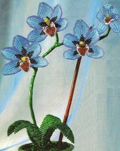 Wonderful beaded orchid. Terrible instructions, but worth it to sit down and try to figure out.